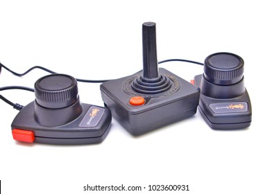 Classic Atari 2600 controllers. Illustrative editorial image on a white background.