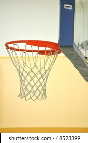 Classic basketball rim with hoop.