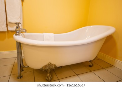 Classic bathtub with legs decorated in a sink