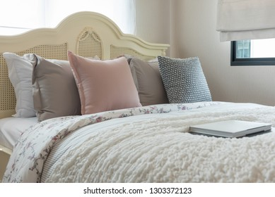 classic bedroom style with set of pillows on bed and classic lamp in white color tone, interior design decoration concept
