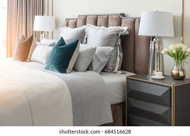 classic bedroom style with set of pillows and lamp on table side, interior design concept