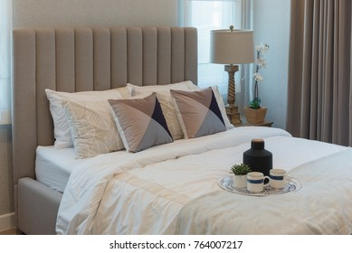 classic bedroom style with set of pillows on white blanket, interior design concept