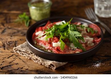 Classic beef carpaccio with arugula