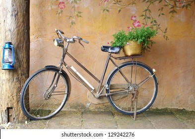 classic bicycle in front of art wall background