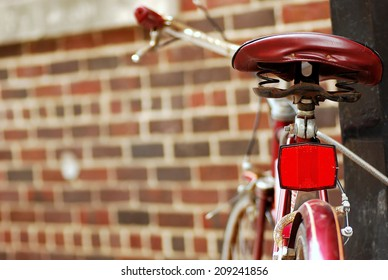 A Classic Bicycle is Locked Up Against a Brick Wall on State Street in Madison