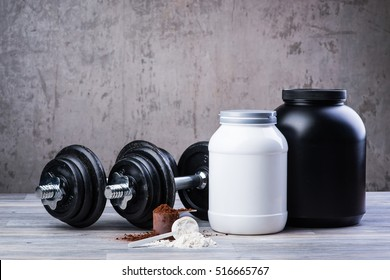 Classic black dumbbells with two protein jars