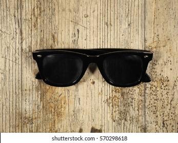 Classic black men's sunglasses on a wood background