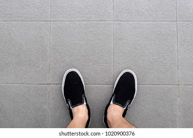 classic black sneaker on the ground
