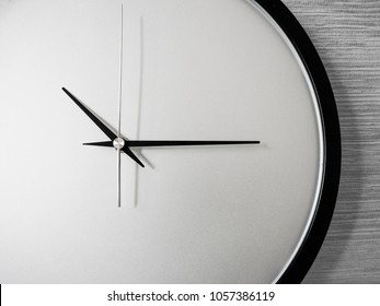 Classic black and white clock no number but tell time that fifteen minutes pass ten which on line cotton background.