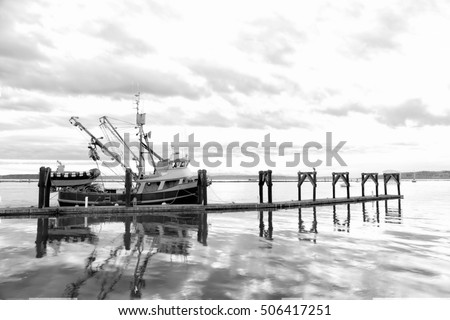 Classic black and white in low key of a cape purse seiner commercial fishing boat
