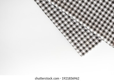 Classic black and white plaid fabric or tablecloth on white background