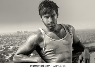 Classic black and white portrait of a young handsome man above city skyline