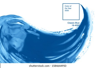 Classic blue color of paint splash. Acrilic brush texture. Paint stroke isolated on white background with text. Color of Year 2020 concept
