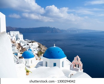 Classic Blue dome church and the Sea in Oia, Santorini, Greece