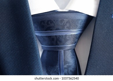 Classic blue suit, shirt and tie, close up, top view