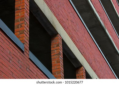 classic brick industrial building facade with windows and open floors for wallpaper