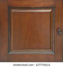 classic brown mahogany door panel with bordered frame