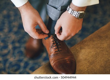 Classic brown shoes on the feet of the groom