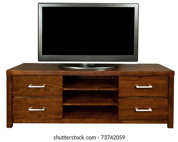 A classic brown wooden TV cabinet with a large LCD TV on it.