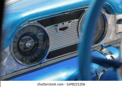 Classic Buick automobile blue interior dash and instrument cluster with speedometer and steering wheel.