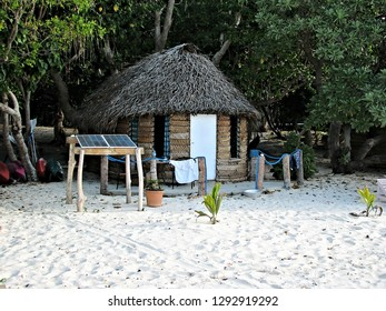 Classic bure or beach bungalow located at a sandy beach waterfront on a remote island in the South Pacific ocean supported by solar energy to meet the needs of electricty