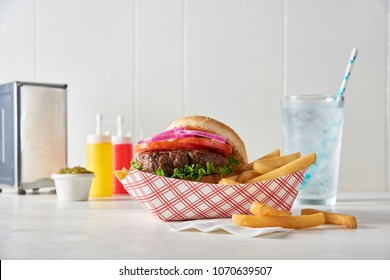 Classic Burger and Fries in a Restaurant Setting