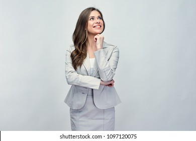 Classic business portrait of smiling woman with long hair wearing gray suit looking up. Isolated studio back.