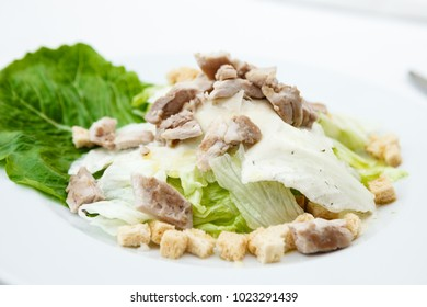 Classic Caesar salad with chicken on a plate
