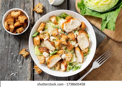 Classic caesar salad with grilled chicken fillet and parmesan cheese. top view