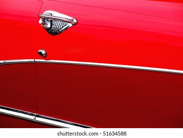 Classic candy apple red vintage car side