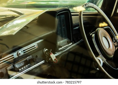 Classic car console with vintage steering wheel.  Close up car console with vintage style.