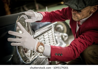 Classic Car Damage Appraisal. Caucasian Collector in His 30s Looking For Imperfections on the Car Body.