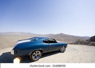 Classic car in desert (lens flare)