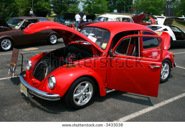 A classic car displayed at a street antique car show - the Beetle