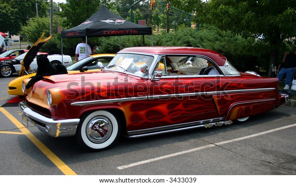A classic car displayed at a street antique car show - 1953 Mercury