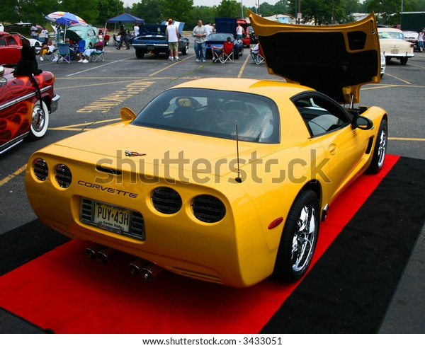 A classic car displayed at a street antique car show - The Corvette