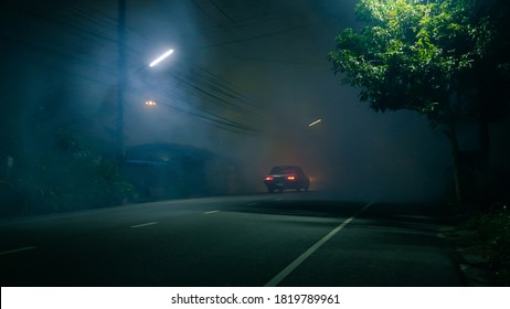 Classic car drive into abandoned road with large group of smoke and ghost town concept