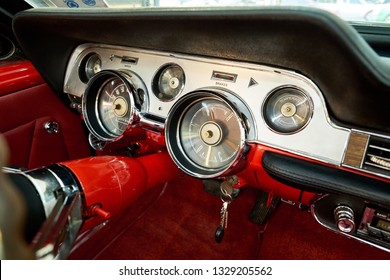 Classic car interior. Analog speedometer and classic tachometer on dashboard. Close up of classic gauge and steering column. Car detailing & restoration of vintage concept.