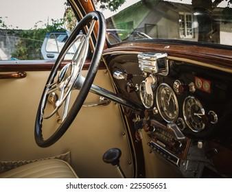 Classic car interior. Wheel and dashboard.