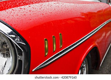 Classic car in the rain.