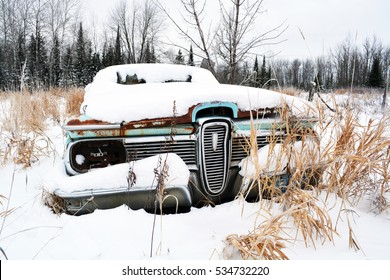 Classic Car Rusting Away in a Field in the Winter  - Ford