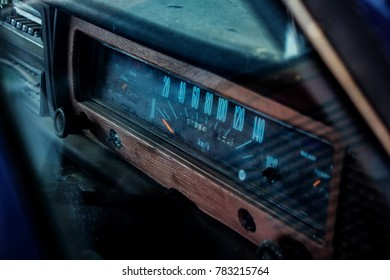 Classic Car Speedometer. Vintage car speed gauge frame with brown wood and black console.