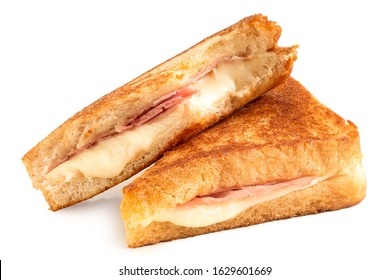 Classic cheese and ham toasted sandwich cut in half isolated on white.