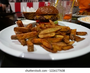 Classic cheeseburger with thick fries in a american diner