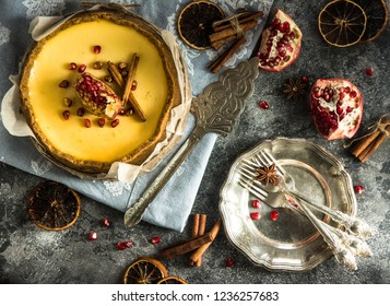 Classic cheesecake with cinnamon on a dark background. Winter version of  cake. Christmas