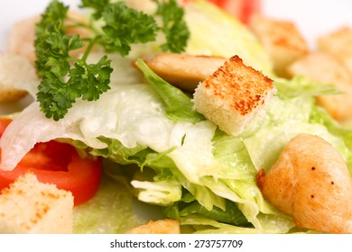 A classic chicken caesar salad with vegetables