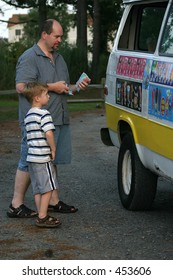 Classic Childhood.. A father and son buy dessert from an ice cream truck.