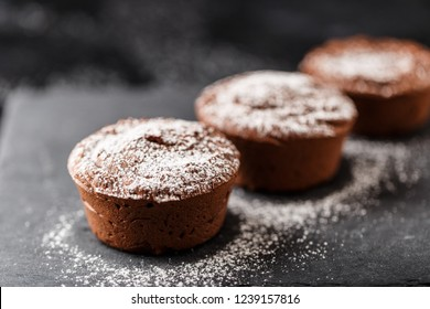 Classic chocolate fondant on a dark background. Chocolate muffins
