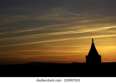 Classic church silhouette on tropical sunset