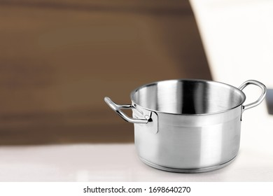 Classic clean steel pot without a lid on the desk